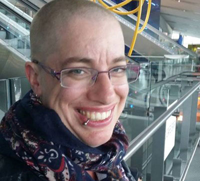 Image shows fundraiser, Katy Hall, after shaving her hair to raise funds for UCLH neonatal unit.