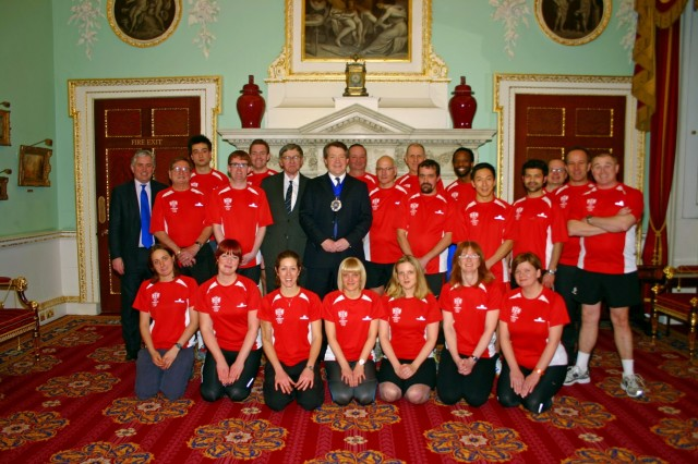 Pat Timoney (right of the mayor) and members of the 23-mile running club which raised money for the support group